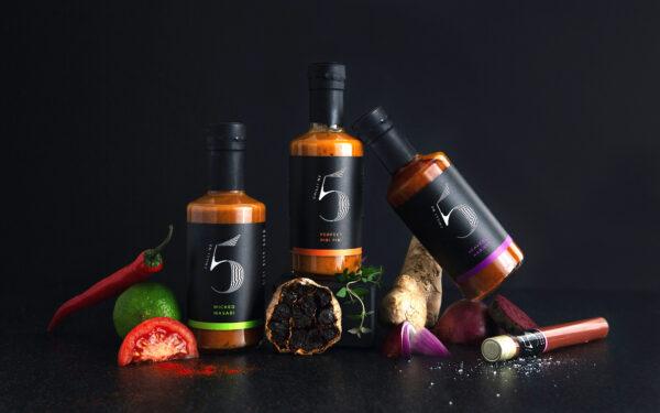 Multiple large bottles of chilli sauce including Luxury Harissa Sauce - Chilli No. 5